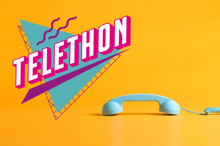 "A curly-corded telephone handset rests in the lower right hand corner. A logo, in a a1980's style, reads ""telethon""."